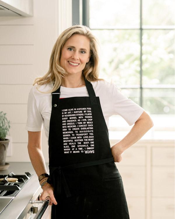 Farrell Mason standing in her kitchen